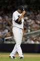 Sep 26, 2013; Bronx, NY, USA; New York Yankees starting pitcher Ivan Nova (47) reacts after giving up a solo home run to Tampa Bay Rays designated hitter Delmon Young (not pictured) during the seventh inning of a game at Yankee Stadium. Mandatory Credit: Brad Penner-USA TODAY Sports