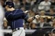 Sep 26, 2013; Bronx, NY, USA; Tampa Bay Rays third baseman Evan Longoria (3) hits a two-RBI single against the New York Yankees during the eighth inning of a game at Yankee Stadium. Mandatory Credit: Brad Penner-USA TODAY Sports