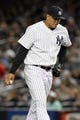 Sep 26, 2013; Bronx, NY, USA; New York Yankees relief pitcher Dellin Betances (61) reacts after giving up two runs against the Tampa Bay Rays during the eighth inning of a game at Yankee Stadium. Mandatory Credit: Brad Penner-USA TODAY Sports