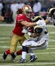 Sep 26, 2013; St. Louis, MO, USA; San Francisco 49ers defensive back Raymond Ventrone (41) tackles St. Louis Rams running back Benny Cunningham (36) during the second half at the Edward Jones Dome. The 49ers defeated the Rams 35-11. Mandatory Credit: Scott Rovak-USA TODAY Sports