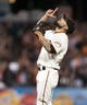 Sep 26, 2013; San Francisco, CA, USA; San Francisco Giants relief pitcher Sergio Romo (54) points to the sky after retiring the last batter of the game against the Los Angeles Dodgers at AT&T Park. The San Francisco Giants defeated the Los Angeles Dodgers 3-2. Mandatory Credit: Ed Szczepanski-USA TODAY Sports