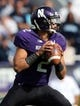 Sep 21, 2013; Evanston, IL, USA; Northwestern Wildcats quarterback Kain Colter (2) throws a pass while wearing a wristband with the phrase APU written on it during the game against the Maine Black Bears at Ryan Field.  Mandatory Credit: Jerry Lai-USA TODAY Sports