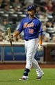 Sep 27, 2013; New York, NY, USA; New York Mets center fielder Juan Lagares (12) reacts after striking out with the bases loaded against the Milwaukee Brewers during the sixth inning of a game at Citi Field. Mandatory Credit: Brad Penner-USA TODAY Sports