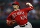Sep 27, 2013; Arlington, TX, USA; Los Angeles Angels starting pitcher C.J. Wilson (33) delivers a pitch to the Texas Rangers during the first inning of a baseball game at Rangers Ballpark in Arlington. Mandatory Credit: Jim Cowsert-USA TODAY Sports