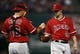 Sep 27, 2013; Arlington, TX, USA; Los Angeles Angels starting pitcher C.J. Wilson (33) and catcher Hank Conger (16) meet on the mound against the Texas Rangers during the first inning of a baseball game at Rangers Ballpark in Arlington. Mandatory Credit: Jim Cowsert-USA TODAY Sports