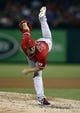 Sep 27, 2013; Arlington, TX, USA; Los Angeles Angels starting pitcher C.J. Wilson (33) follows through on his delivery to the Texas Rangers during the first inning of a baseball game at Rangers Ballpark in Arlington. Mandatory Credit: Jim Cowsert-USA TODAY Sports