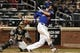 Sep 27, 2013; New York, NY, USA; New York Mets left fielder Lucas Duda (21) hits a single against the Milwaukee Brewers during the sixth inning at Citi Field. Mandatory Credit: Brad Penner-USA TODAY Sports