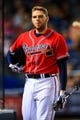 Sep 27, 2013; Atlanta, GA, USA; Atlanta Braves first baseman Freddie Freeman (5) reacts to striking out in the seventh inning against the Philadelphia Phillies at Turner Field. Mandatory Credit: Daniel Shirey-USA TODAY Sports