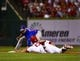 Sep 27, 2013; St. Louis, MO, USA; St. Louis Cardinals second baseman Matt Carpenter (13) is tagged out by Chicago Cubs second baseman Darwin Barney (15) while attempting to stretch a single at Busch Stadium. Mandatory Credit: Scott Rovak-USA TODAY Sports