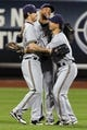 Sep 27, 2013; New York, NY, USA; Milwaukee Brewers left fielder Logan Schafer (22), center fielder Carlos Gomez (27), and right fielder Norichika Aoki (7) celebrate after defeating the New York Mets 4-2 at Citi Field. Mandatory Credit: Brad Penner-USA TODAY Sports