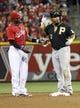 Sep 27, 2013; Cincinnati, OH, USA; Pittsburgh Pirates right fielder Marlon Byrd (2) stands at second with Cincinnati Reds second baseman Brandon Phillips (4) after Byrd hit a double in the sixth inning at Great American Ball Park. Pittsburgh won 4-1. Mandatory Credit: David Kohl-USA TODAY Sports