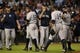 Sep 27, 2013; Houston, TX, USA; New York Yankees shortstop Derek Jeter (2) and right fielder Ichiro Suzuki (31) celebrate defeating the Houston Astros 3-2 at Minute Maid Park. Mandatory Credit: Thomas Campbell-USA TODAY Sports