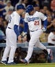 Sep 27, 2013; Los Angeles, CA, USA; Los Angeles Dodgers first baseman Adrian Gonzalez (23) celebrates with left fielder Alex Castellanos (26) after scoring a home run in the third inning against the Colorado Rockies at Dodger Stadium. Mandatory Credit: Jayne Kamin-Oncea-USA TODAY Sports