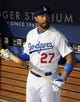 Sep 27, 2013; Los Angeles, CA, USA; Los Angeles Dodgers center fielder Matt Kemp (27) stands in the dugout prior to the game against the Colorado Rockies at Dodger Stadium. Mandatory Credit: Jayne Kamin-Oncea-USA TODAY Sports