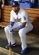 Sep 27, 2013; Los Angeles, CA, USA; Los Angeles Dodgers center fielder Matt Kemp (27) sits in the dugout prior to the game against the Colorado Rockies at Dodger Stadium. Mandatory Credit: Jayne Kamin-Oncea-USA TODAY Sports