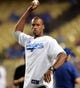 Sep 27, 2013; Los Angeles, CA, USA; NBA player Jason Collins throws out the first pitch at the first annual LGBT Night Out at Dodger Stadium prior to the game against the Los Angeles Dodgers and the Colorado Rockies. Mandatory Credit: Jayne Kamin-Oncea-USA TODAY Sports