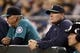 Sep 27, 2013; Seattle, WA, USA; Seattle Mariners manager Eric Wedge (right) stands in the dugout during the fifth inning against the Oakland Athletics at Safeco Field. Mandatory Credit: Joe Nicholson-USA TODAY Sports