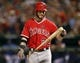 Sep 27, 2013; Arlington, TX, USA; Los Angeles Angels center fielder Josh Hamilton (32) reacts after striking out against the Texas Rangers during the eighth inning of a baseball game at Rangers Ballpark in Arlington. The Rangers won 5-3. Mandatory Credit: Jim Cowsert-USA TODAY Sports