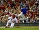 Sep 27, 2013; St. Louis, MO, USA; Chicago Cubs third baseman Donnie Murphy (8) makes a catch as St. Louis Cardinals right fielder Carlos Beltran (3) slides into third base safely on an errant throw by Cubs catcher Dioner Navarro (not pictured) at Busch Stadium. The Cardinals defeated the Cubs 7-0 to win the National League Central Title. Mandatory Credit: Scott Rovak-USA TODAY Sports