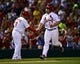 Sep 27, 2013; St. Louis, MO, USA; St. Louis Cardinals left fielder Matt Holliday (7) is congratulated by Cardinals third base coach Jose Oquendo (11) after hitting a solo home run against the Chicago Cubs at Busch Stadium. The Cardinals defeated the Cubs 7-0 to win the National League Central Title. Mandatory Credit: Scott Rovak-USA TODAY Sports