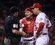 Sep 27, 2013; St. Louis, MO, USA; St. Louis Cardinals manager Mike Matheny (22) and catcher Yadier Molina (4) question umpire Brian Knight (91) on a call during the game against the Chicago Cubs at Busch Stadium. The Cardinals defeated the Cubs 7-0 to win the National League Central Title. Mandatory Credit: Scott Rovak-USA TODAY Sports