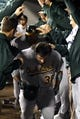 Sep 27, 2013; Seattle, WA, USA; Oakland Athletics pinch hitter Derek Norris (36) is greeted at the dugout after hitting a two-run home run against the Seattle Mariners during the seventh inning at Safeco Field. Mandatory Credit: Joe Nicholson-USA TODAY Sports