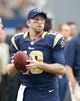 Sep 22, 2013; Arlington, TX, USA; St. Louis Rams quarterback Kellen Clemens (10) warms up on the sidelines during the game against the Dallas Cowboys at AT&T Stadium. The Dallas Cowboys beat the St. Louis Rams 31-7. Mandatory Credit: Tim Heitman-USA TODAY Sports