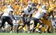 Sep 28, 2013; Morgantown, WV, USA; Oklahoma State Cowboys quarterback J.W. Walsh (4) rolls out to pass against the West Virginia Mountaineers at Milan Puskar Stadium. Mandatory Credit: Peter Casey-USA TODAY Sports