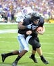 Sep 28, 2013; Chapel Hill, NC, USA; East Carolina Pirates quarterback Shane Carden (5) runs for a touchdown as North Carolina Tarheels safety Dominique Green attempts to make a tackle during the first half at Kenan Memorial Stadium. Mandatory Credit: Rob Kinnan-USA TODAY Sports