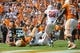 Sep 28, 2013; Knoxville, TN, USA; Tennessee Volunteers running back Marlin Lane (15) scores a touchdown while being tackled by South Alabama Jaguars linebacker Bryson James (38) during the second quarter at Neyland Stadium. Mandatory Credit: Randy Sartin-USA TODAY Sports