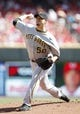 Sep 28, 2013; Cincinnati, OH, USA; Pittsburgh Pirates starting pitcher Charlie Morton (50) pitches during the first inning against the Cincinnati Reds at Great American Ball Park. Mandatory Credit: Frank Victores-USA TODAY Sports