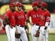 Sep 28, 2013; Arlington, TX, USA; Texas Rangers players Adrian Beltre and Ian Kinsler and Mitch Moreland and Elvis Andrus (left to right) talk during a pitching change against the Los Angeles Angels during the fifth inning of a baseball game at Rangers Ballpark in Arlington. Mandatory Credit: Jim Cowsert-USA TODAY Sports