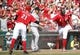 Sep 28, 2013; Cincinnati, OH, USA; Cincinnati Reds second baseman Brandon Phillips (4) is congratulated by third baseman Todd Frazier (21) after scoring during the third inning against the Pittsburgh Pirates at Great American Ball Park. Mandatory Credit: Frank Victores-USA TODAY Sports