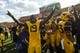 Sep 28, 2013; Morgantown, WV, USA; West Virginia Mountaineers wide receiver Kj Myers (19) celebrates after beating the Oklahoma State Cowboys at Milan Puskar Stadium. Mandatory Credit: Peter Casey-USA TODAY Sports