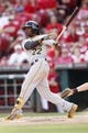 Sep 28, 2013; Cincinnati, OH, USA; Pittsburgh Pirates center fielder Andrew McCutchen (22) bats during the ninth inning against the Cincinnati Reds at Great American Ball Park. The Pirates defeated the Reds 8-3. Mandatory Credit: Frank Victores-USA TODAY Sports