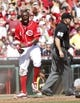 Sep 28, 2013; Cincinnati, OH, USA; Cincinnati Reds second baseman Brandon Phillips (4) reacts after scoring during the third inning against the Pittsburgh Pirates at Great American Ball Park. Mandatory Credit: Frank Victores-USA TODAY Sports