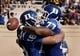 Sep 28, 2013; Durham, NC, USA;  Duke Blue Devils guard Laken Tomlinson (77) celebrates with quarterback Brandon Connette (18) after Connette scored against the Troy Trojans at Wallace Wade Stadium. Mandatory Credit: Mark Dolejs-USA TODAY Sports