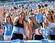 Sep 28, 2013; Chapel Hill, NC, USA; North Carolina Tarheels fans Alyssa Radel , Rachel Gogal and Mckenzie Bennet (left to right) cheer at the beginning of the fourth quarter against the East Carolina Pirates at Kenan Memorial Stadium.  ECU won 55-31. Mandatory Credit: Rob Kinnan-USA TODAY Sports