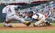 Sep 28, 2013; Minneapolis, MN, USA; Cleveland Indians third baseman Mike Aviles (4) is called safe at home in the fifth inning as Minnesota Twins catcher Eric Fryer (54) applies the late tag at Target Field. Mandatory Credit: Brad Rempel-USA TODAY Sports