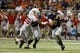 Sep 28, 2013; San Antonio, TX, USA; Texas-San Antonio Roadrunners quarterback Eric Soza (8) attempts to elude Houston Cougars defensive end Trevor Harris (46) during the first half at Alamodome. Mandatory Credit: Soobum Im-USA TODAY Sports