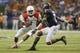 Sep 28, 2013; San Antonio, TX, USA; Houston Cougars quarterback Greg Ward Jr. (1) attempts to elude Texas-San Antonio Roadrunners safety Triston Wade (7) during the first half at Alamodome. Mandatory Credit: Soobum Im-USA TODAY Sports