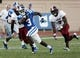Sep 28, 2013; Durham, NC, USA;  Duke Blue Devils wide receiver Jamison Crowder (3) runs past Troy Trojans safety Chris Pickett (7) at Wallace Wade Stadium. Mandatory Credit: Mark Dolejs-USA TODAY Sports