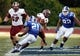 Sep 28, 2013; Durham, NC, USA;  Troy Trojans wide receiver Chandler Worthy (16) runs the ball against Duke Blue Devils safety Anthony Young-Wiseman (21) and defensive tackle Sydney Sarmiento (82) at Wallace Wade Stadium. Mandatory Credit: Mark Dolejs-USA TODAY Sports