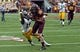 Sep 28, 2013; Minneapolis, MN, USA; Minnesota Golden Gophers wide receiver Derrick Engel (18) runs to the end zone for a touchdown as Iowa Hawkeyes quarterback Cody Sokol (19) attempts to make a tackle in the second half at TCF Bank Stadium. The Hawkeyes won 23-7. Mandatory Credit: Jesse Johnson-USA TODAY Sports