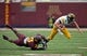 Sep 28, 2013; Minneapolis, MN, USA; Minnesota Golden Gophers linebacker James Manuel (9) tackles Iowa Hawkeyes quarterback Jake Rudock (15) in the second half at TCF Bank Stadium. The Hawkeyes won 23-7. Mandatory Credit: Jesse Johnson-USA TODAY Sports