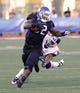 Sep 28, 2013; Buffalo, NY, USA; Buffalo Bulls running back Branden Oliver (32) runs as Connecticut Huskies cornerback Byron Jones (16) dives for a tackle during the second half at University of Buffalo Stadium. Buffalo beat Connecticut 41-12. Mandatory Credit: Kevin Hoffman-USA TODAY Sports