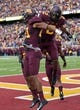 Sep 28, 2013; Minneapolis, MN, USA; Minnesota Golden Gophers defensive back Brock Vereen (21) celebrates with defensive back Cedric Thompson (2) after intercepting a pass in the second half against the Iowa Hawkeyes at TCF Bank Stadium. The Hawkeyes won 23-7. Mandatory Credit: Jesse Johnson-USA TODAY Sports