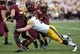 Sep 28, 2013; Minneapolis, MN, USA; Iowa Hawkeyes defensive lineman Dominic Alvis (79) sacks Minnesota Golden Gophers quarterback Philip Nelson (9) in the second half at TCF Bank Stadium. The Hawkeyes won 23-7. Mandatory Credit: Jesse Johnson-USA TODAY Sports