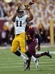 Sep 28, 2013; Minneapolis, MN, USA; Iowa Hawkeyes wide receiver Kevonte Martin-Manley (11) catches a pass in front of Minnesota Golden Gophers defensive back Eric Murray (31) in the second half at TCF Bank Stadium. The Hawkeyes won 23-7. Mandatory Credit: Jesse Johnson-USA TODAY Sports