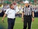 Sep 28, 2013; South Bend, IN, USA; Notre Dame Fighting Irish head coach Brian Kelly talks with referee Randy Christal in the fourth quarter against the Oklahoma Sooners at Notre Dame Stadium. Oklahoma won 35-21. Mandatory Credit: Matt Cashore-USA TODAY Sports